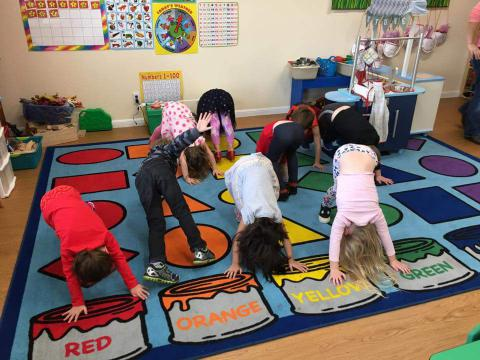 Preschool kids doing yoga
